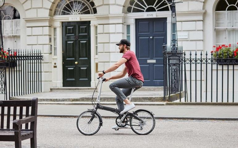 guy on fold away bike