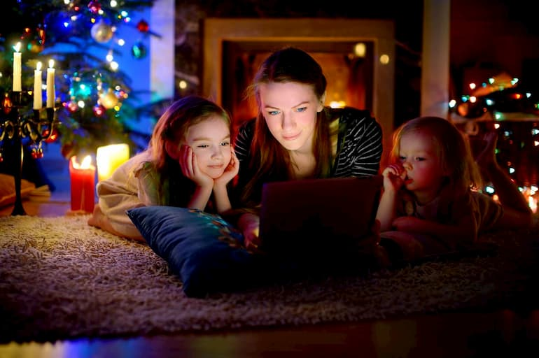 whatching christmas films near fireplace