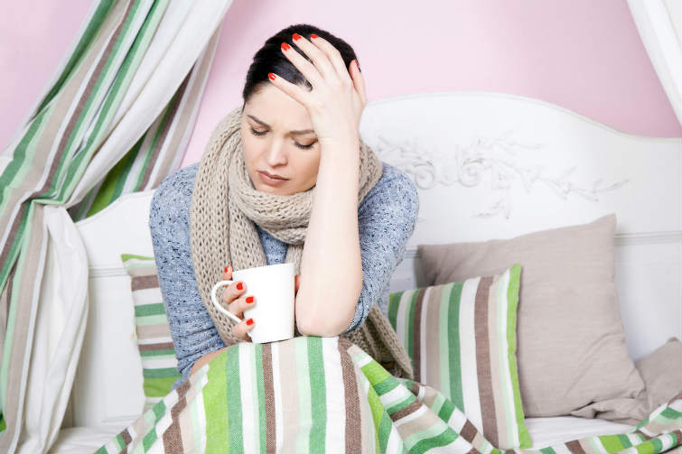 Sick women with flu cold vitamins
