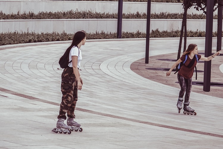 picture of two girls in the park with inline rollerblades