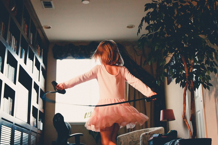 picture of a girl in a ballerina dress dancing at home