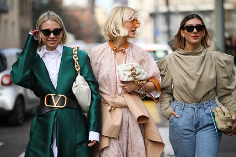 picture of three women wearing stylish clothes