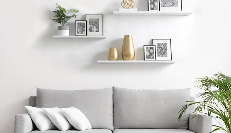 grey sofa bed with decorative shelves and rug