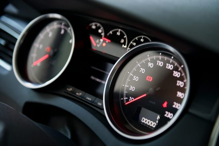 man-checking-his-cars-dashboard-gauges-vehicle gauges and instruments